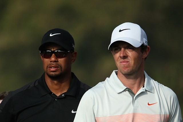 タイガー・ウッズ(左)とロリー・マキロイは2014年、クラブのセッティングを一新した(Warren Little/Getty Images)
