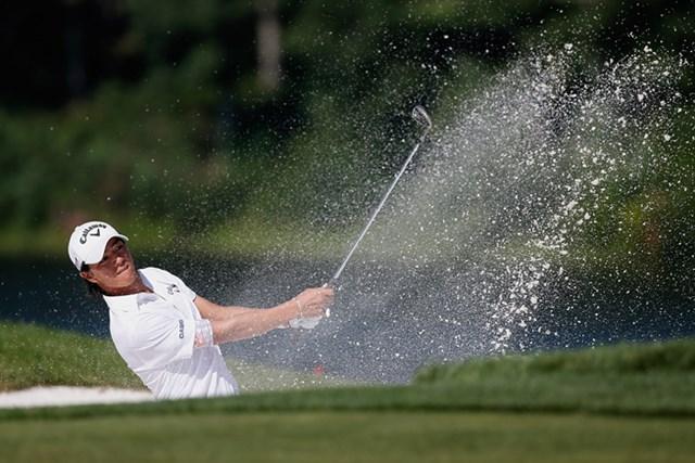 出入りの激しい内容ながら「68」と伸ばし、単独首位で決勝ラウンドを迎える石川遼(Rob Carr/Getty Images)