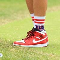地元ニューヨークのフットボールチームのロゴソックスを履くのは、ポール・ケーシーのキャディのマク 2019年 全米プロゴルフ選手権 最終日 ニューヨークジャイアンツ