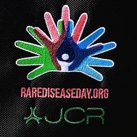 「Rare Disease Day」のロゴは手と手を取り合う様子 川村昌弘のスポンサーロゴ