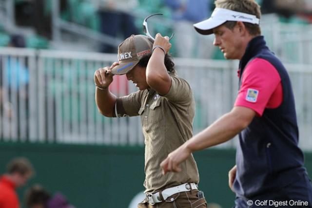 2011年 全英オープン 2日目 石川遼 80をたたき通算14オーバーで予選落ちの石川遼、右の世界ナンバー1L.ドナルドも予選落ち
