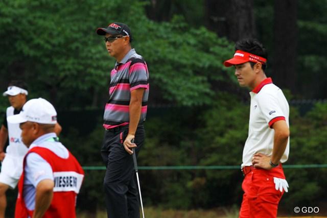 2014年 全米オープン 2日目 キム・ヒョンソン 谷口徹 キム・ヒョンソン(写真右)は10オーバー予選落ち。自ら選んだ強行日程だが…